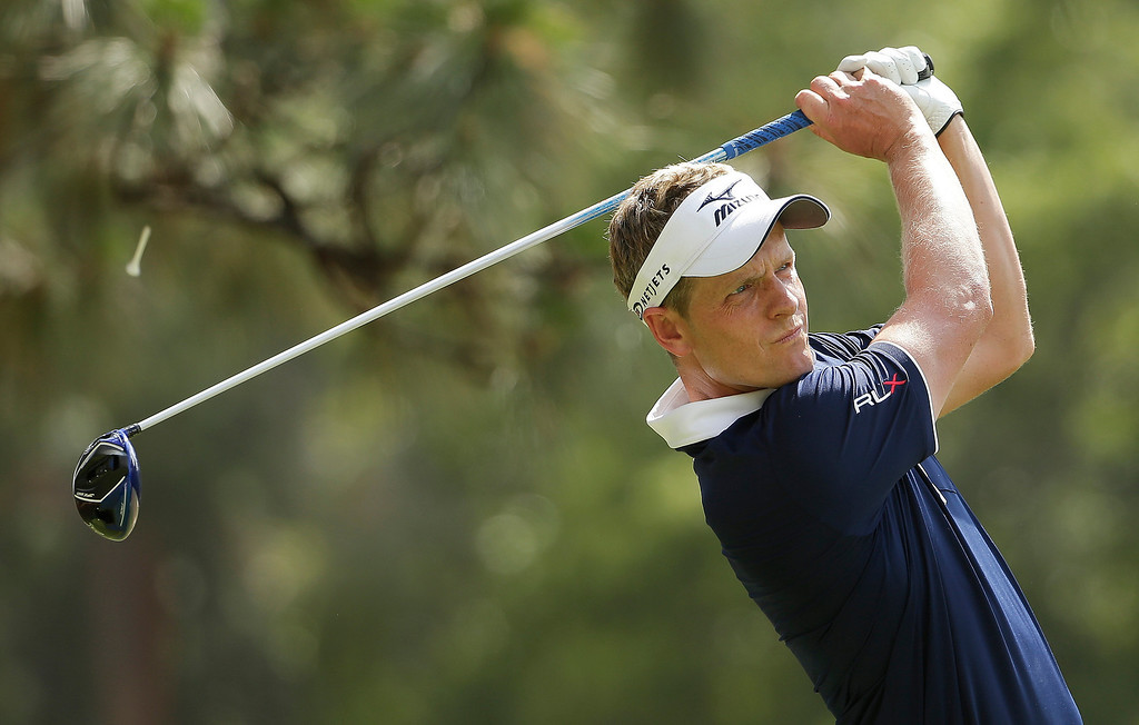 . Luke Donald, of England, watches his tee shot on the second hole during the first round of the U.S. Open golf tournament in Pinehurst, N.C., Thursday, June 12, 2014. (AP Photo/Chuck Burton)