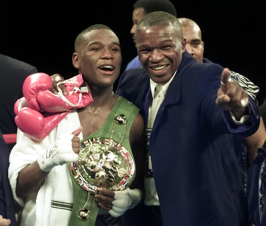 . Floyd Mayweather, left, of Grand Rapids, Mich., stands in the ring with his father, Floyd Mayweather Sr., after defeating Diego Corrales of Sacramento, Calif., in their WBC super featherweight championship fight in Las Vegas, in this Jan. 20, 2001 file photo. Floyd Mayweather Jr. and Oscar De La Hoya will soon have their own HBO reality show to promote their megafight in May. Mayweather and his poetry-spewing father could host one themselves, now that they have reconciled with one goal in mind: beating the man Mayweather\'s father used to train, De La Hoya. (AP Photo/Eric Risberg)