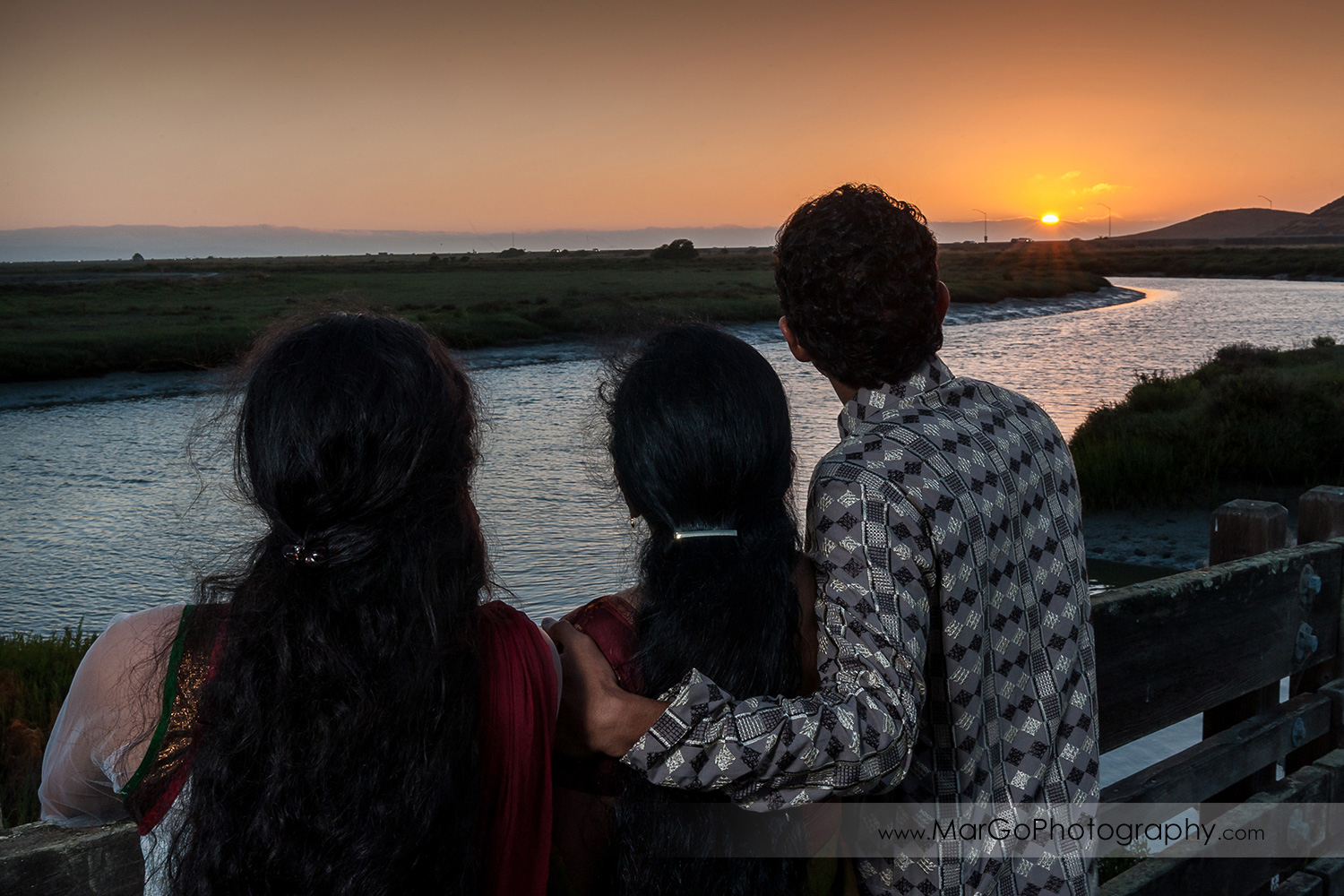 Indian family looking at sunset at Don Edwards Refuge in Fremont