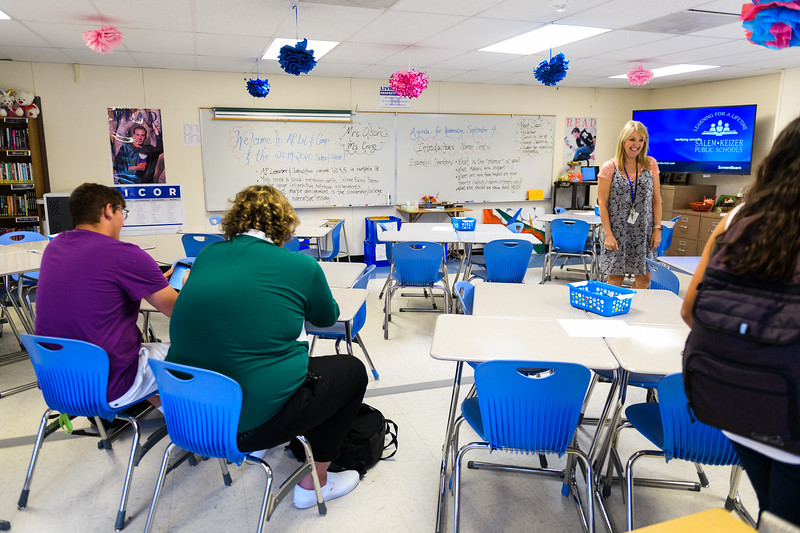 Teacher Linda Olson greets her students in the newly-built portable classrooms. Back to school day at McNary High School on Wednesday, September 4, 2019 in Keizer, Ore.