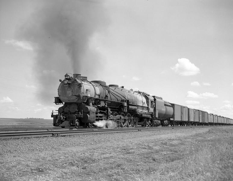 UP_4-12-2_9007-with-train_east-of-Cheyenne_July-1949_Jim-Ady-photo.jpg