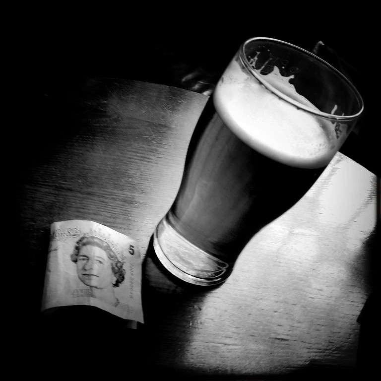 . A pint of beer and a five pounds banknote on May 2, 2012 in London, England. Shot in April 2012 ahead of the London 2012 Olympics. (Photo by Vittorio Zunino Celotto/Getty Images)