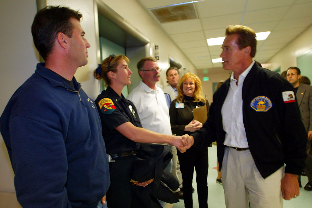 . SAN DIEGO - NOVEMBER 3:  Governor-Elect Arnold Schwarzenegger shakes the hands of member of the Fire Department while visiting burn victims from the Cedar Fire at the UCSD Regional Burn Center November 3, 2003 in San Diego, California.  (Photo by Donald Miralle/Getty Images)