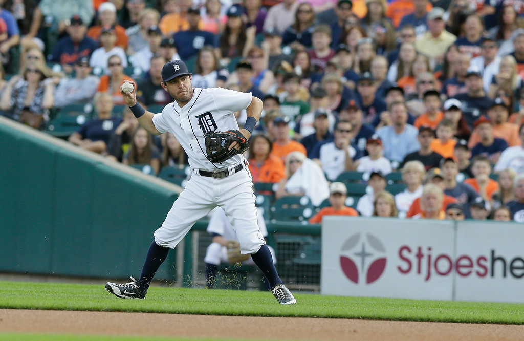 . Detroit Tigers\' Ian Kinsler throws to first during the first inning of a baseball game against the Seattle Mariners, Friday, Aug. 15, 2014 in Detroit. (AP Photo/Carlos Osorio)