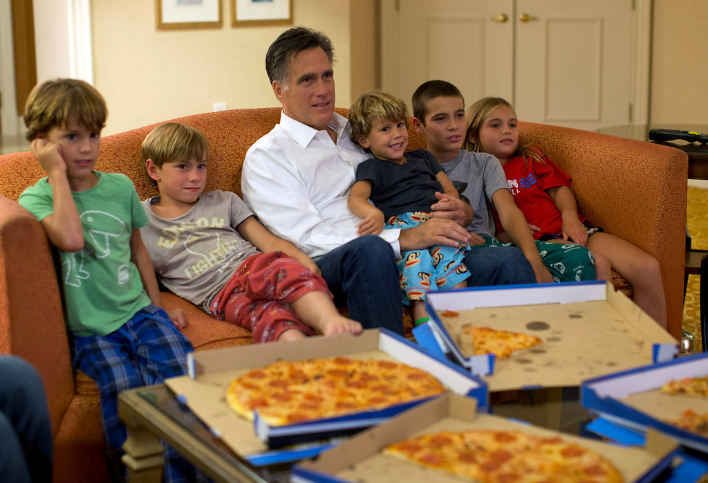 . In this Aug. 29, 2012 file photo, Republican presidential candidate, former Massachusetts Gov. Mitt Romney watches the Republican National Convention with his grandchildren from his hotel room in Tampa, Fla.  (AP Photo/Evan Vucci, File)