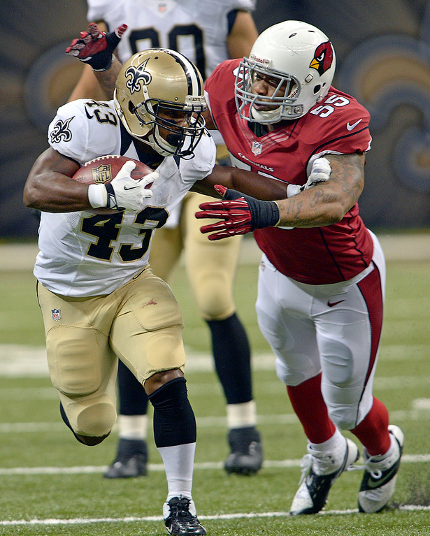 . New Orleans Saints running back Darren Sproles (43) rushes against Arizona Cardinals defensive end John Abraham (55) in the second half of an NFL football game in New Orleans, Sunday, Sept. 22, 2013. (AP Photo/Bill Feig)
