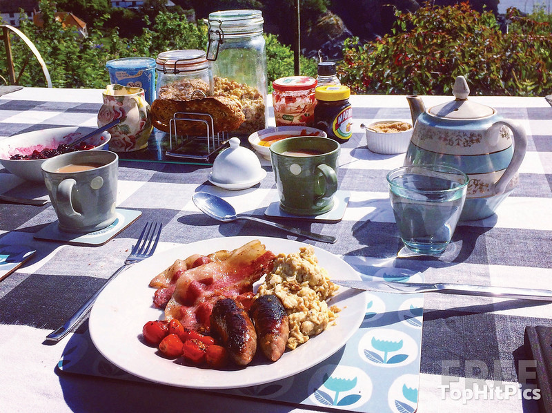 A Traditional English Breakfast with Tea, Toast, Sausages, Bacon, Eggs and Marmite!
