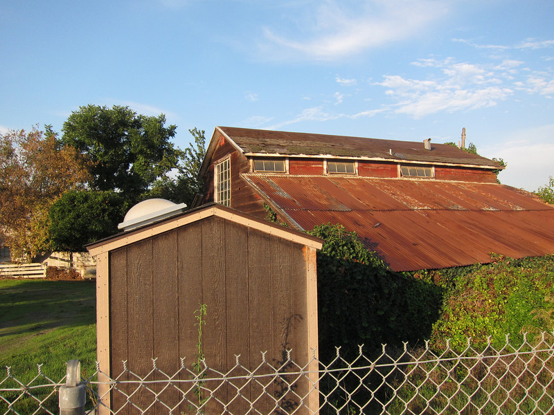 Coyote Creek Trail ran alongside this old farm property. Barn's falling apart, but--um--what exactly is this little building in the front, with the skylight?