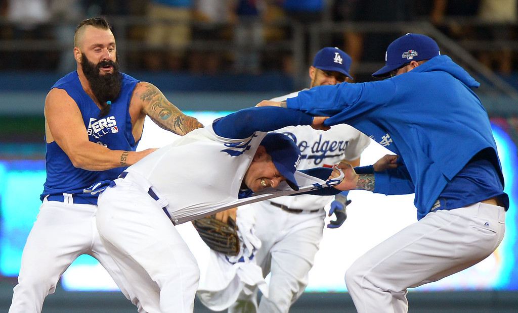. Dodger players celebrate follwing their victory over the Braves October 7, 2013.(Andy Holzman/Los Angeles Daily News )