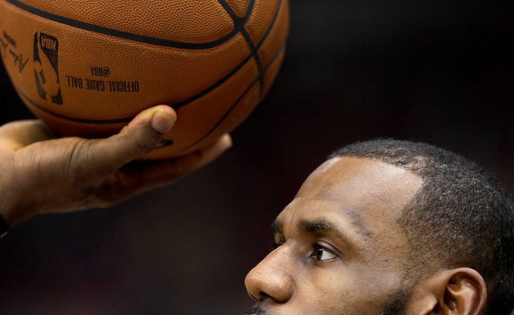 . Cleveland Cavaliers\' LeBron James shoots one handed during warmups before an NBA basketball game against the Chicago Bulls Monday, Dec. 4, 2017, in Chicago. (AP Photo/Charles Rex Arbogast)