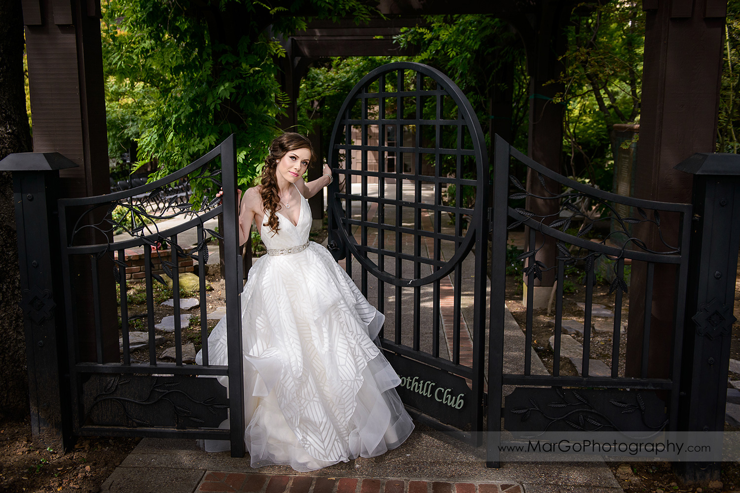 portrait of bride standing in gate at Saratoga Foothill Club