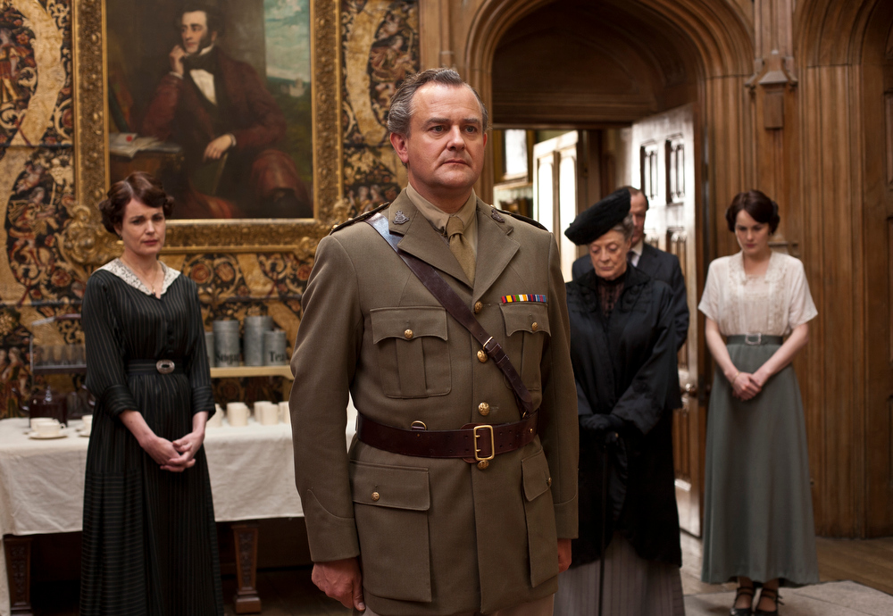 Description of . In this image released by PBS, from left, Elizabeth McGovern as Lady Cora, Hugh Bonneville as Lord Grantham, Maggie Smith as the Dowager Countess and Michelle Dockery as Lady Mary are shown in a scene from the second season of