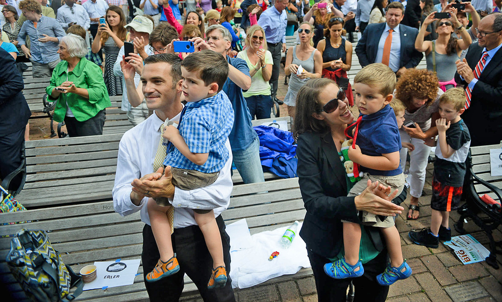 . Rebekah Erler, right, and her family applaud after President Barack Obama finished his speech at the Lake Harriet Bandshell. (Pioneer Press: Ben Garvin)