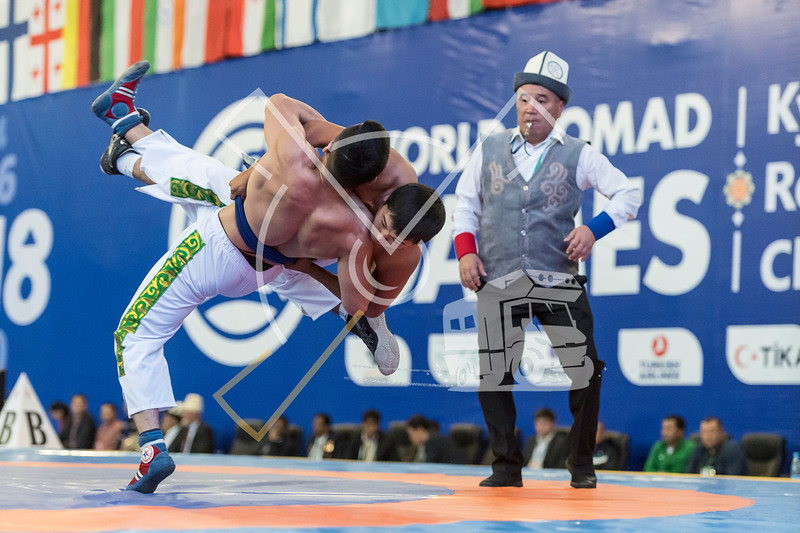 Two wrestlers fall on their heads during a Kyrgyz kurosh competition during the World Nomad Games 2018 in Kyrgyzstan.