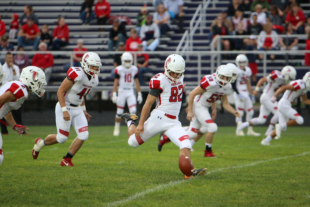 . Kyle Sooy - The Morning Journal<br> Firelands kicker Alex Brill kicks off against Vermilion on Sept. 7.