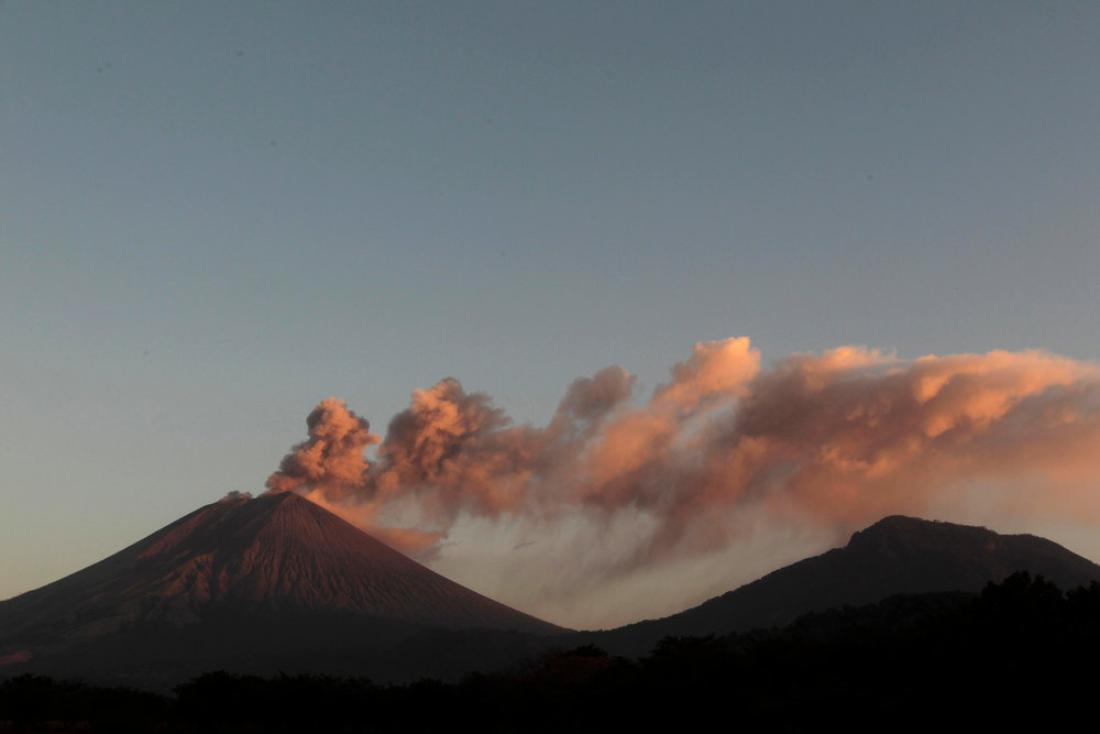Description of . The San Cristobal volcano spews up large clouds of gas and ash near Chinandegga City, some 150 km (93 miles) north of the capital Managua December 26, 2012. The 5,725-foot (1,745-meter) San Cristobal volcano, one of the tallest in Nicaragua, has belched an ash cloud hundreds of meters into the sky in the latest bout of sporadic activity, prompting the evacuation of nearby residents, the government said on Wednesday. REUTERS/Oswaldo Rivas
