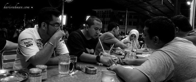 090504 Makan  Dabbling about with the black and white setting. I am well impressed with the LX3 low light capability and the quality of the pics taken. The initial picture was rather under-exposed. It needed some leveling in Photoshop to make it better.