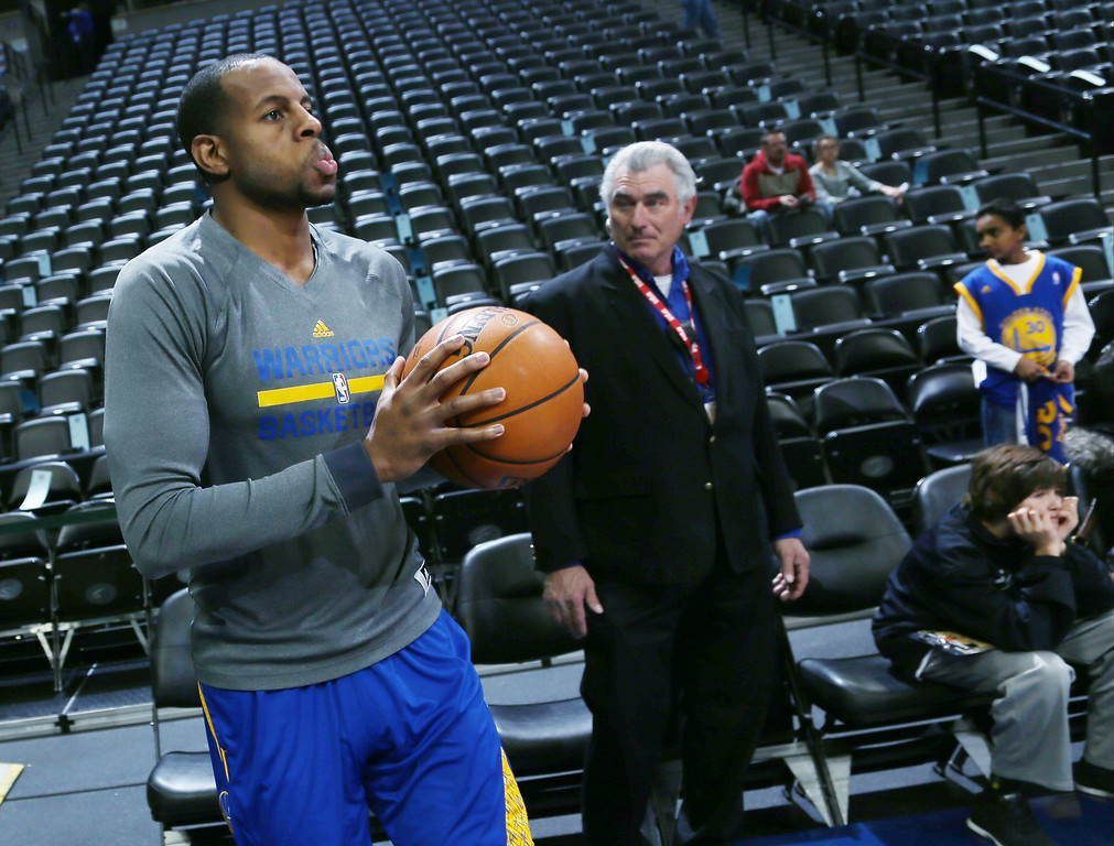. Golden State Warriors guard Andre Iguodala, foreground, steps onto the court of the Pepsi Center to warm up before facing the Denver Nuggets in an NBA basketball game in Denver, Monday, Dec. 23, 2013. Iguodala is making his first appearance in Denver since being dealt by the Nuggets to Golden State in the off-season. (AP Photo/David Zalubowski)
