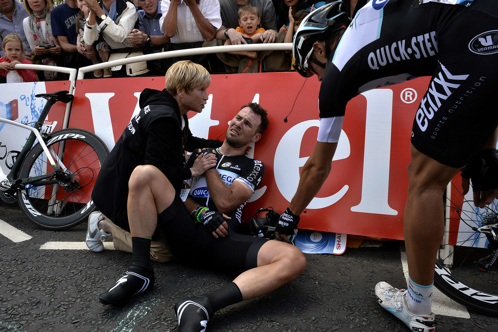 . Britain\'s Mark Cavendish injured receives medical assistance after a fall near the finish line at the end of the 190.5 km first stage of the 101st edition of the Tour de France cycling race on July 5, 2014 between Leeds and Harrogate, northern England.  The 2014 Tour de France gets underway on July 5 in the streets of Leeds and ends on July 27 down the Champs-Elysees in Paris. JEFF PACHOUD/AFP/Getty Images