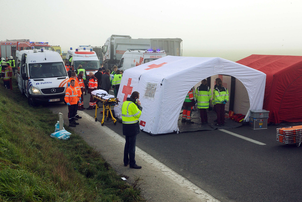 . A picture shows rescue services at the site of a multiple collision accident on the A19 highway towards Kortrijk, near Zonnebeke-Beselare,  on December 3, 2013.  AFP PHOTO/BELGA/ERIC LALMAND/AFP/Getty Images