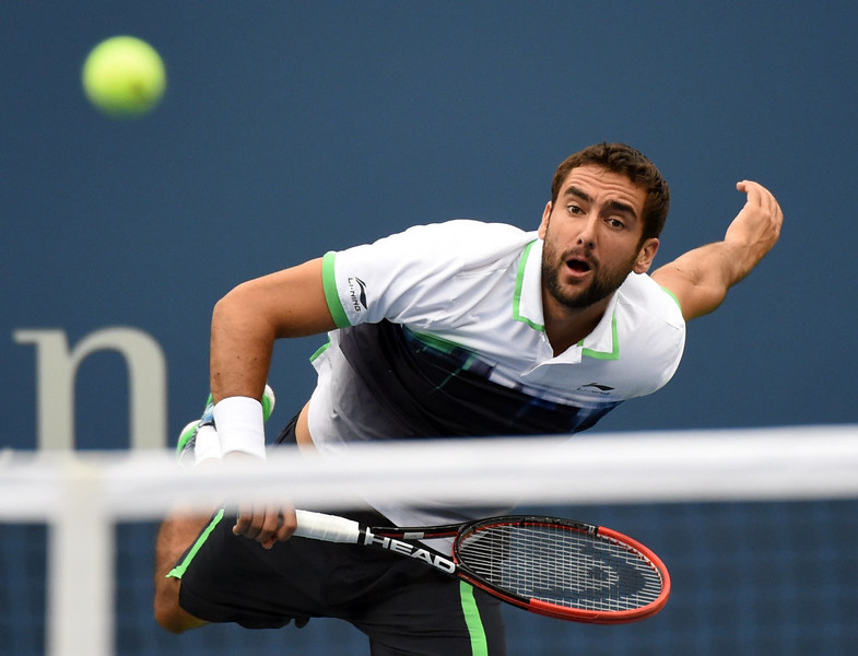 . Marin Cilic of Croatia serves to Kei Nishikori of Japan during their US Open 2014 men\'s singles finals match at the USTA Billie Jean King National Center September 8, 2014  in New York. TIMOTHY A. CLARY/AFP/Getty Images