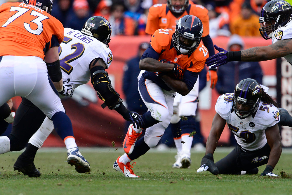 Description of . Denver Broncos running back Ronnie Hillman (21) runs up the middle for a short gain  in the second quarter. The Denver Broncos vs Baltimore Ravens AFC Divisional playoff game at Sports Authority Field Saturday January 12, 2013. (Photo by AAron  Ontiveroz,/The Denver Post)
