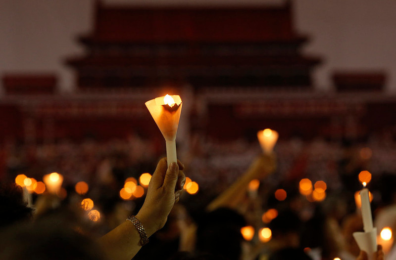 . Tens of thousands of people attend a candlelight vigil at Victoria Park in Hong Kong Tuesday June 4, 2013 to mark the 24th anniversary of the June 4th Chinese military crackdown on the pro-democracy movement in Beijing. (AP Photo/Vincent Yu)