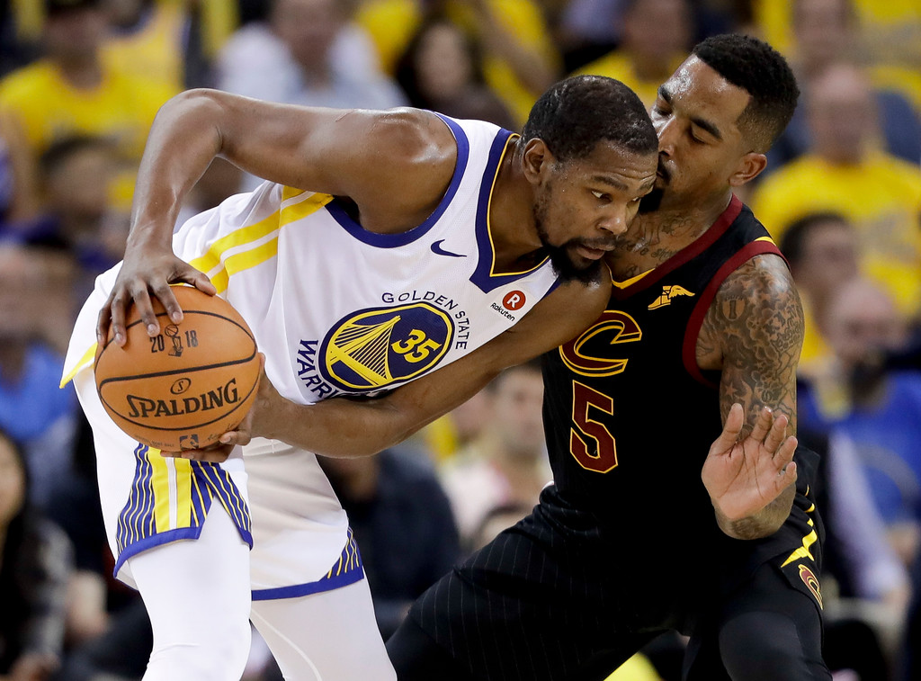. Golden State Warriors forward Kevin Durant (35) is defended by Cleveland Cavaliers guard J.R. Smith during the second half of Game 1 of basketball\'s NBA Finals in Oakland, Calif., Thursday, May 31, 2018. (AP Photo/Marcio Jose Sanchez)