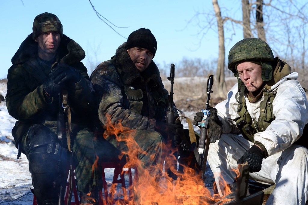 . Pro-Russian rebels warm themselves by a fire during a break between fighting near the eastern Ukrainian city of Debaltseve on February 17, 2015. Ukraine on February 17 accused rebels and Russia of scuppering a fragile three-day-old ceasefire after insurgents armed with automatic weapons and rocket-propelled grenades stormed the flashpoint town of Debaltseve and engaged thousands of troops there in intense combat. VASILY MAXIMOV/AFP/Getty Images