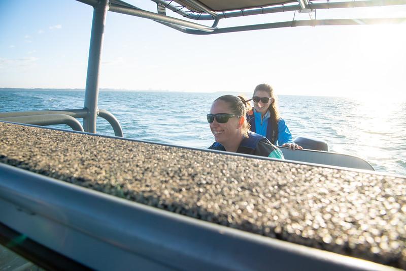 Elani Morgan steers the boat through Corpus Christi Bay.
