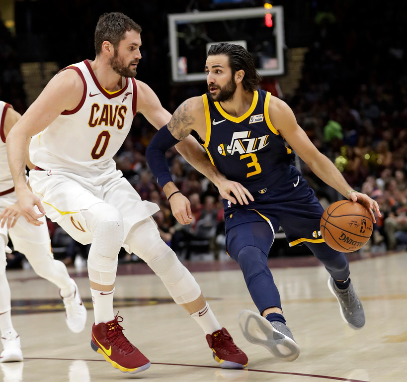 . Utah Jazz\'s Ricky Rubio (3), from Spain, drives past Cleveland Cavaliers\' Kevin Love (0) in the first half of an NBA basketball game, Saturday, Dec. 16, 2017, in Cleveland. (AP Photo/Tony Dejak)