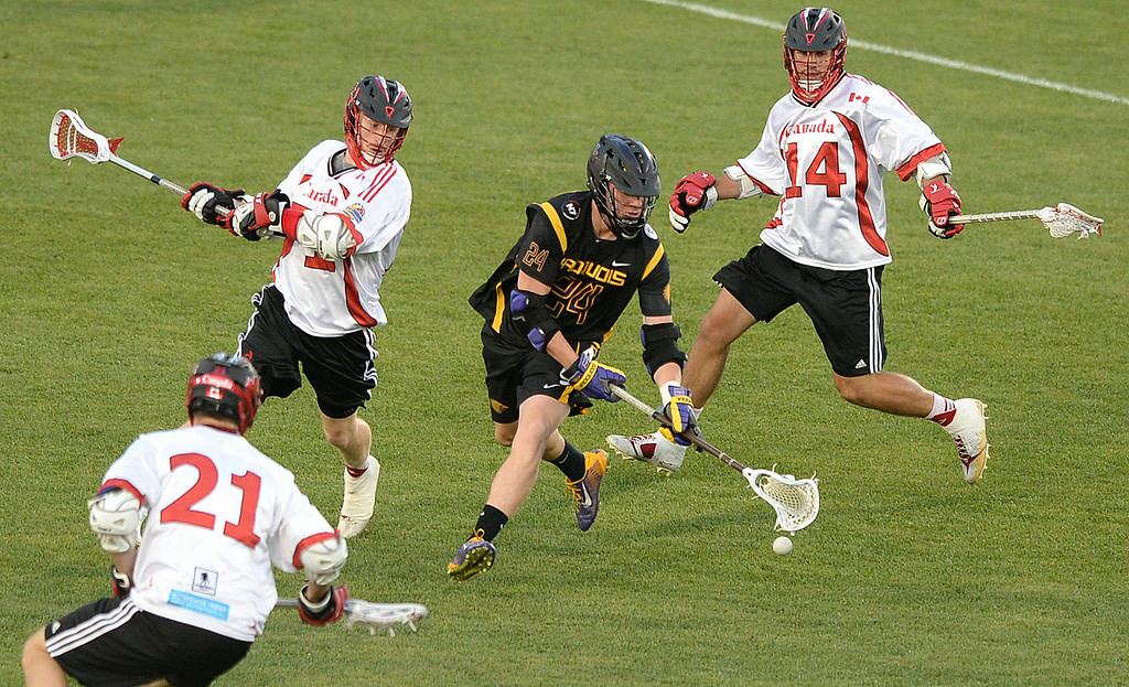 . COMMERCE CITY, CO - JULY 17: Iroquois midfielder Mike Lazore (24) lost the ball in a crowd of Canada players in the first quarter. The Iroquois Nationals took on Canada in a FIL World Championship semifinal game Thursday night, July 17, 2014.  Photo by Karl Gehring/The Denver Post