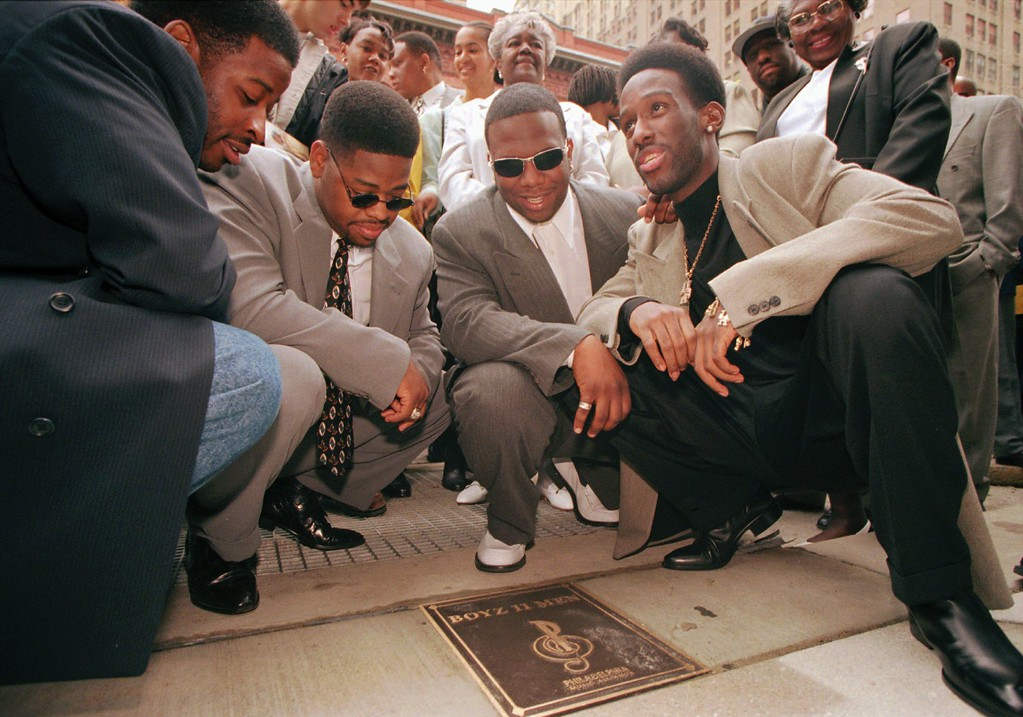 . Boyz II Men members from left, Michael McCary, Nathan Morris, Wanya Morris, and Shawn Stockman, pose with their commemorative plaque in Philadelphia, Thursday, May 9, 1996. The group and other musical artists were honored at the Philadelphia Music Hall of Fame Awards. (AP Photo/Mpozi Mshale Tolbert)