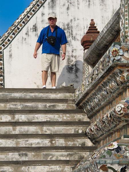 Wat Aroon (Temple of Dawn)  Chris Wadman stops for a moment on his way down from the pagoda.