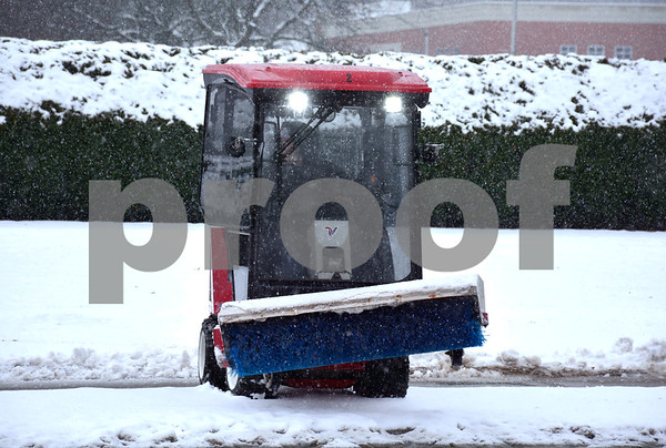 1/17/2018 Mike Orazzi   Staff Snow removal from the sidewalks along Memorial Blvd. Wednesday afternoon in Bristol.