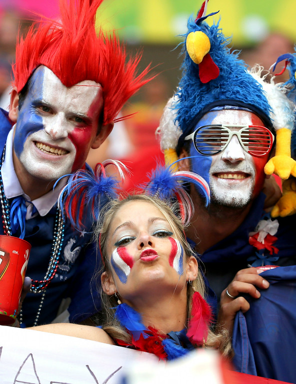 . French supporters react before the World Cup round of 16 soccer match between France and Nigeria at the Estadio Nacional in Brasilia, Brazil, Monday, June 30, 2014. (AP Photo/David Vincent)
