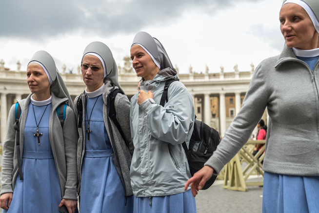 . A group of nuns gather in Saint Peter\'s Square on April 26, 2014 in Vatican City, Vatican. The late Popes John Paul II and John XXIII will be canonised on April 27 inside the Vatican with 800,000 pilgrims from around the world expected to attend.  (Photo by Giorgio Cosulich/Getty Images)