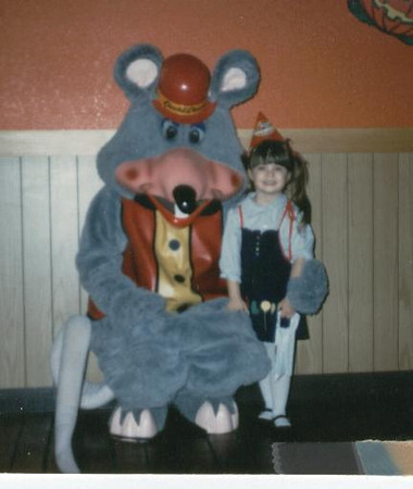 Andi_with_Chuck_E_Cheese_on_her_4th_Birthday.jpg