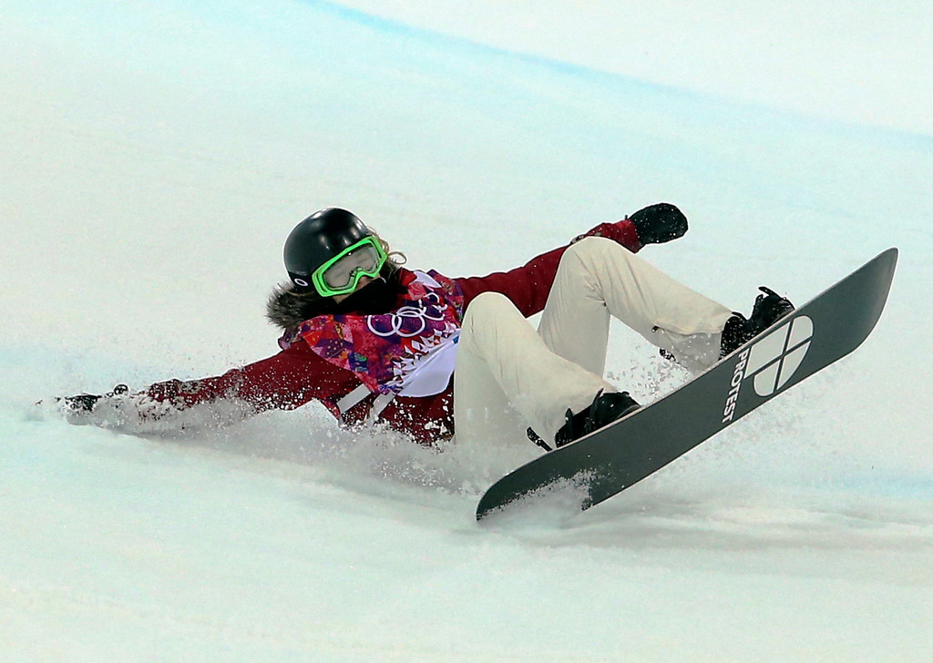 . Switzerland\'s Ursina Haller falls in the women\'s snowboard halfpipe semifinal at the Rosa Khutor Extreme Park, at the 2014 Winter Olympics, Wednesday, Feb. 12, 2014, in Krasnaya Polyana, Russia. (AP Photo/Sergei Grits)