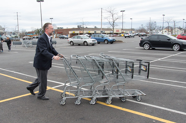 04/11/19 Wesley Bunnell | Staff Stop & Shop worker wearing a name badge with Brian Hamer gathers up carriages in the parking lot at Stop & Shop on Thursday afternoon after store workers went on strike earlier in the day.