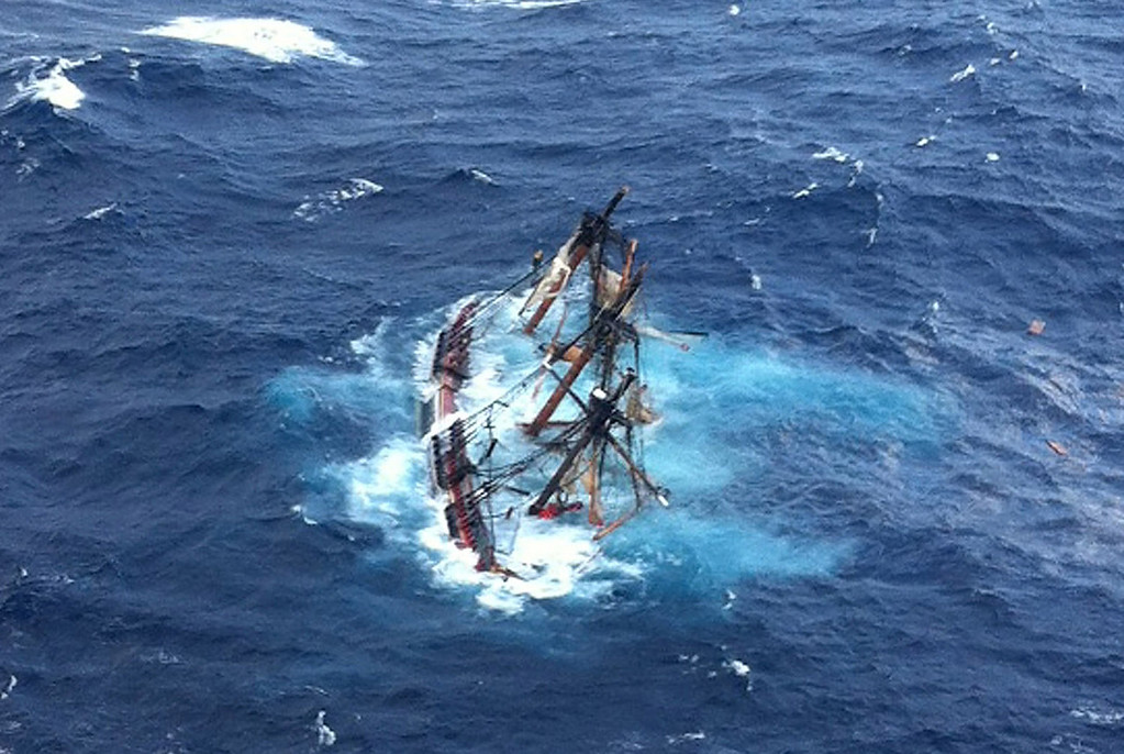. The HMS Bounty, a 180-foot sailboat, is submerged in the Atlantic Ocean during Hurricane Sandy approximately 90 miles southeast of Hatteras, North Carolina, on October 29, 2012. Of the 16-person crew, the Coast Guard rescued 14, recovered a woman who was later pronounced dead and are searching for the captain. The HMS Bounty was built for the 1962 film Mutiny On The Bounty and was also used in Pirates Of The Caribbean. Hurricane Sandy, which threatens 50 million people in the eastern third of the U.S., is expected to bring days of rain, high winds and possibly heavy snow.  (Photo by Petty Officer 2nd Class Tim Kuklewski/ /U.S. Coast Guard via Getty Images)