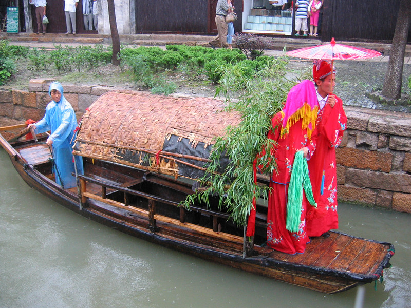 Wedding procession with covered bride, Suchou, China, 2004