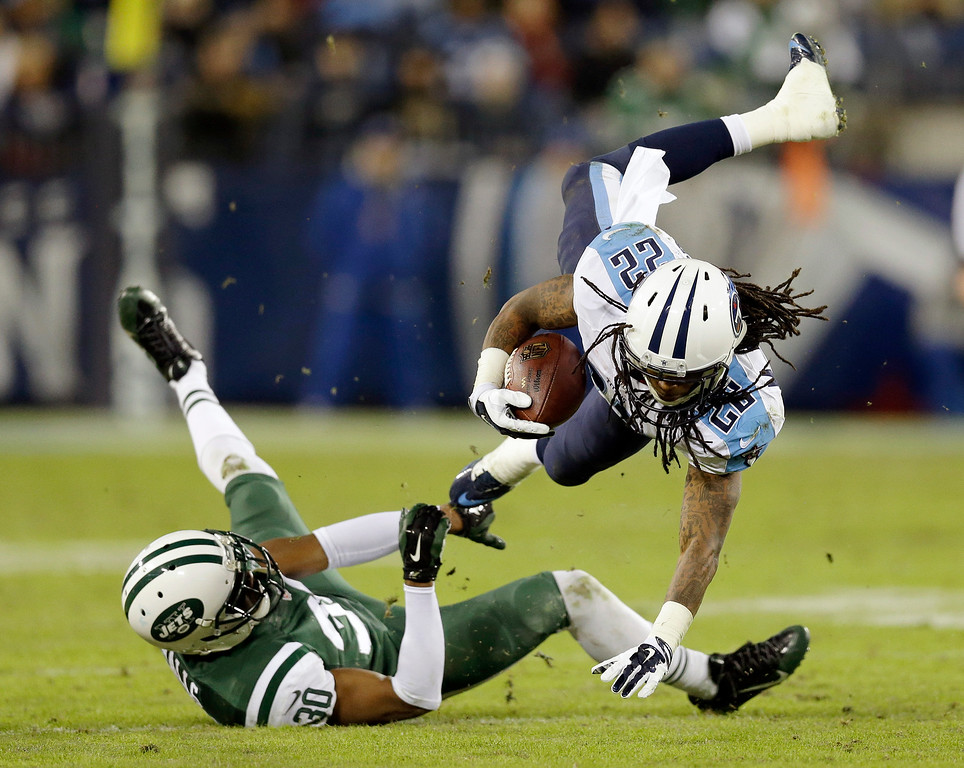 . Tennessee Titans running back Dexter McCluster (22) is brought down by New York Jets cornerback Darrin Walls (30) in the second half of an NFL football game Sunday, Dec. 14, 2014, in Nashville, Tenn. (AP Photo/James Kenney)