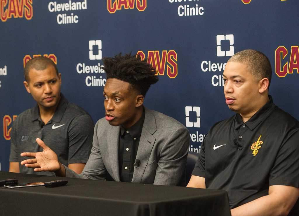 . Cleveland Cavaliers first round draft selection, Collin Sexton, answers a question as Cavaliers general manager Koby Altman, left and Cavaliers head coach Tyronn Lue listen during a news conference at the NBA basketball team\'s training facility in Independence, Ohio, Friday, June 22, 2018.  (AP Photo/Phil Long)