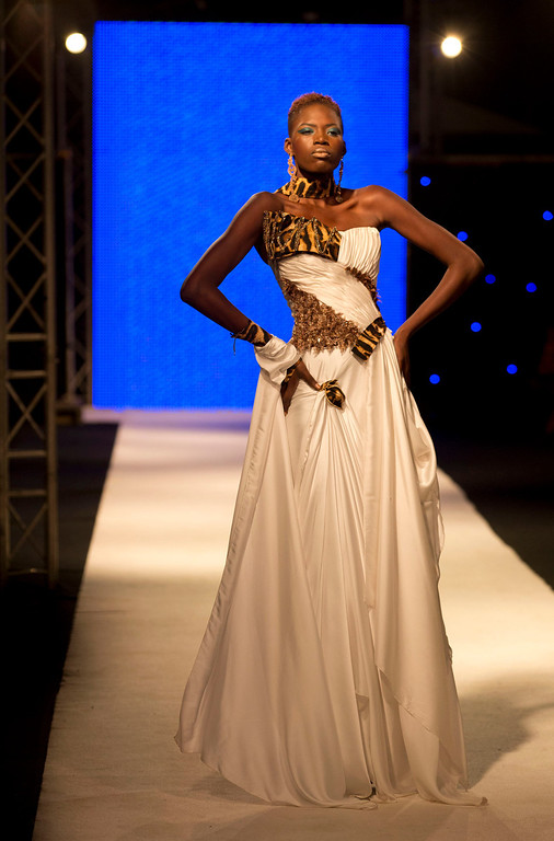 . A model displays a creation by designer Habib Sangare of Ivory Coast, at Hotel des Almadies, in Dakar, Senegal, Saturday, June 22, 2013. After a Friday show held in a dusty marketplace in the working class suburb of Guediawaye, the runway finale of Dakar Fashion Week was held at a luxury hotel and showcased the work of 14 designers from West Africa, Europe, South America, and the Caribbean. (AP Photo/Rebecca Blackwell)