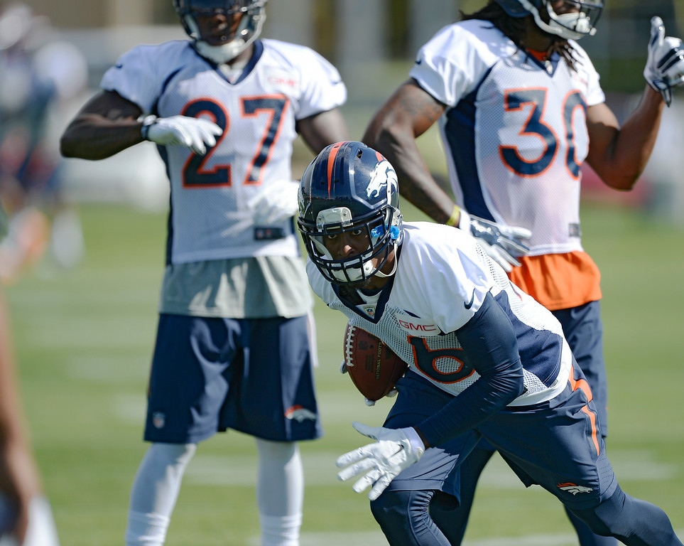 . Denver Broncos free safety Rahim Moore (26) runs through drills during the first day of the Denver Broncos 2014 training camp July 24, 2014 at Dove Valley. (Photo by John Leyba/The Denver Post)