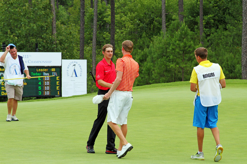 Patrick Rodgers of Avon, IN and Jordan Niebrugge of Mequon, WI shake hands on the green after completing the 72nd hole of stroke play during the 2013 Western Amateur at The Alotian Club in Roland, AR. (WGA Photo/Ian Yelton)