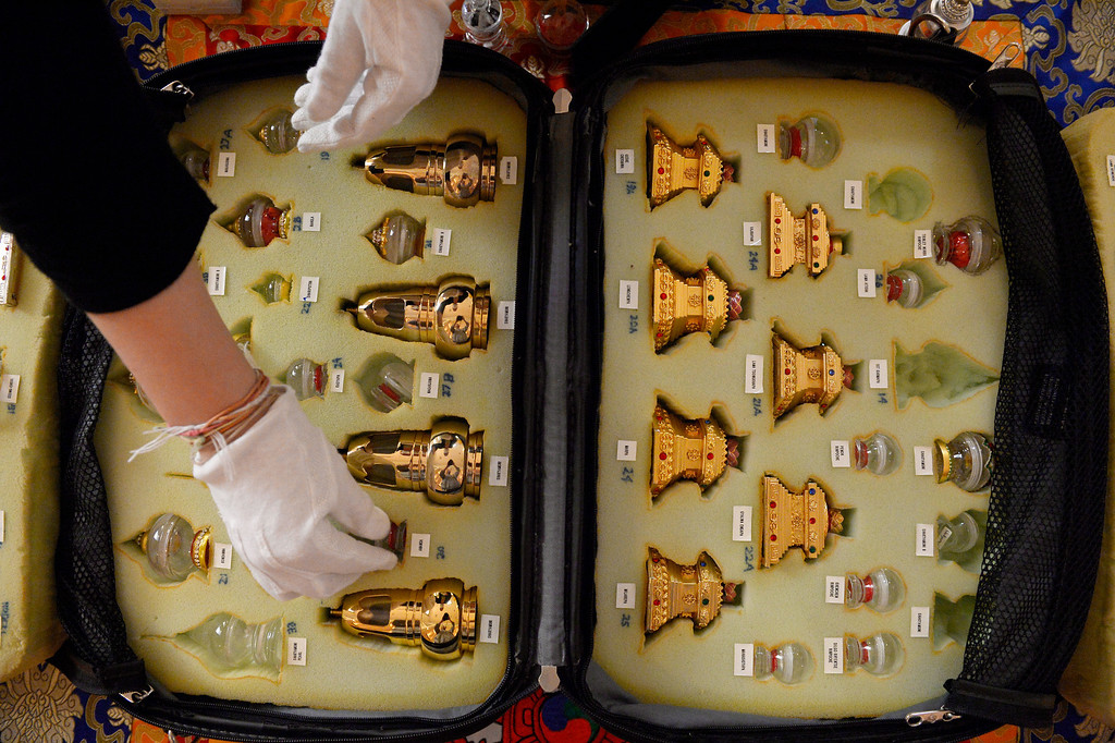 . Tour Manager Amanda Russell displays relics at the Zen Center of Denver in Denver, CO August 23, 2013.  (Photo By Craig F. Walker / The Denver Post)