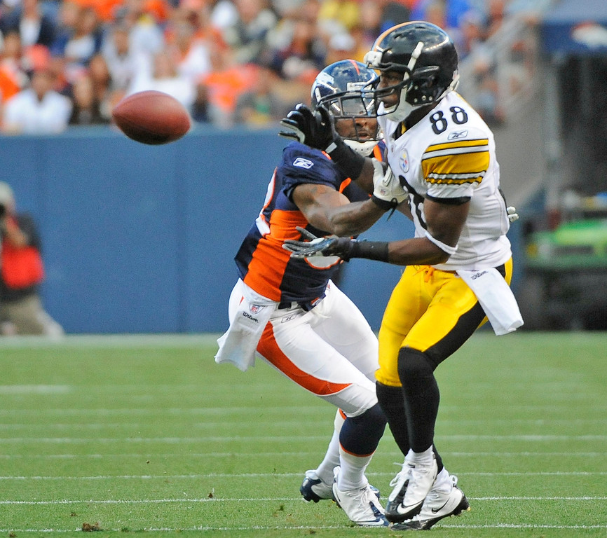 . Denver Broncos\' linebacker Jason Hunter defends a pass to the Pittsburgh Steelers\' Emmanuel Sanders, right,  during first quarter of the Bronco\'s third pre-seaon game Sunday August 29, 2010 at Invesco Field at Mile High. John Leyba, The Denver Post