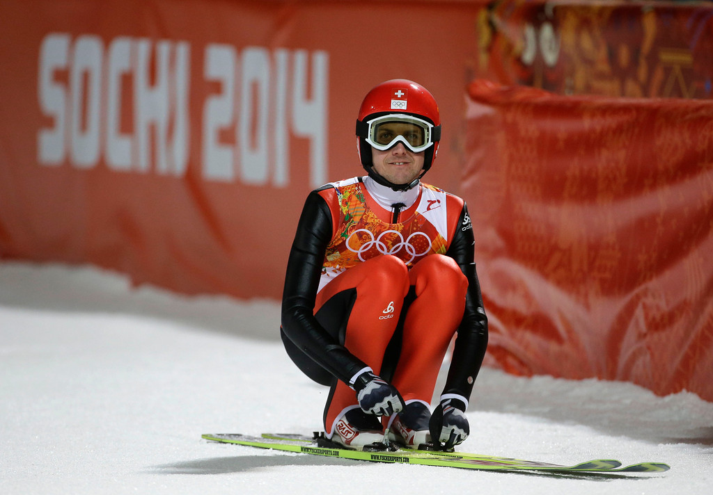 . Switzerland\'s Simon Ammann checks the scoreboard after an attempt during the men\'s normal hill ski jumping qualification at the 2014 Winter Olympics, Saturday, Feb. 8, 2014, in Krasnaya Polyana, Russia. (AP Photo/Gregorio Borgia)